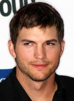 Ashton Kutcher dances like a cowboy at the Country Music Festival