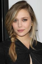Elizabeth Olsen looks chic and modish in oversized sheer white smock