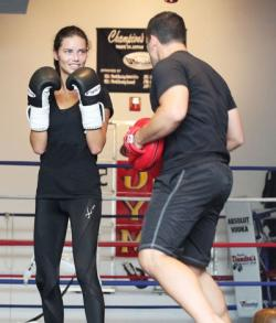 Adriana Lima hits the gym with her trainer for boxing