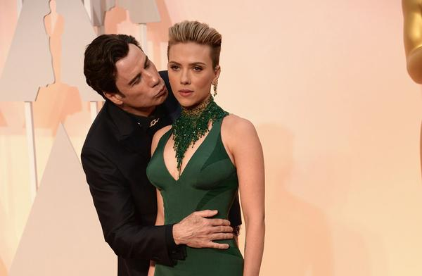 John Travolta, stop touching people!